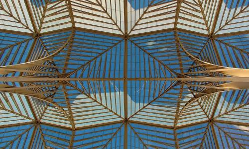 gold metal glass roof structure blue white